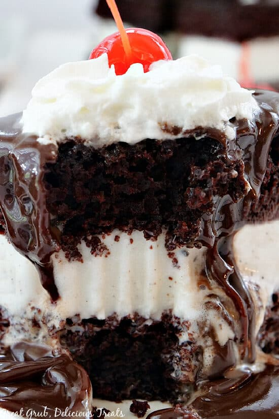 A close up photo of the layers of hot fudge cake; chocolate cake, vanilla ice cream, hot fudge, and whipped cream.