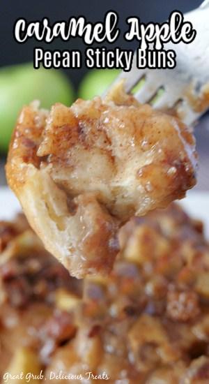 A super close up photo of a bite of sticky buns on a fork.