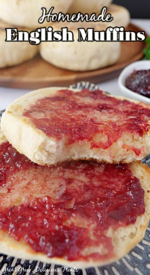 A blue plate with 2 halves of an English muffin on it with jelly on top and a brown plate with muffins on it in the background.