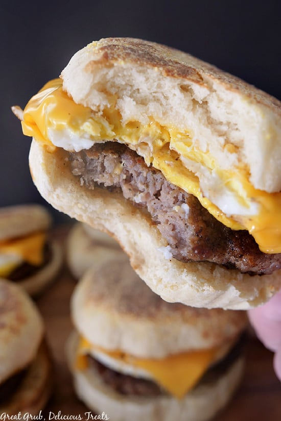 A close up photo of a breakfast sandwich with a bite taken out of it.