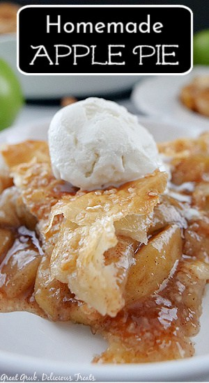 A slice of apple pie in a shallow white bowl with a scoop of vanilla ice cream on top.