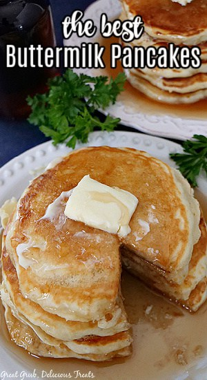 A white plate with four buttermilk pancakes on it with a bite taken out and the title of the recipe at the top.