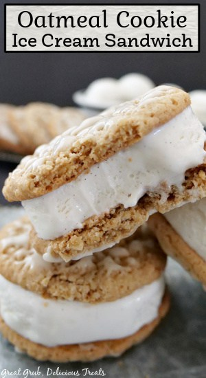 Two ice cream sandwiches  stacked up on a silver plate.