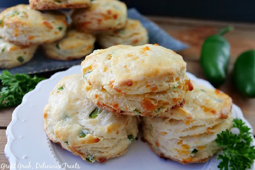 A white plate with three jalapeno cheddar biscuits on it.