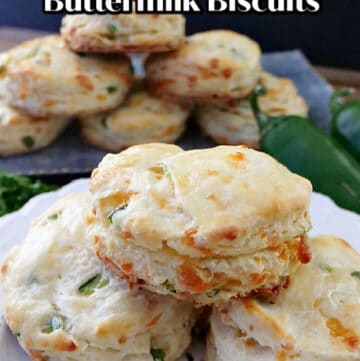 A white plate with 3 jalapeno cheddar buttermilk biscuits.
