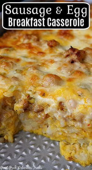 A close up photo of a baking dish with sausage and egg breakfast casserole in it.